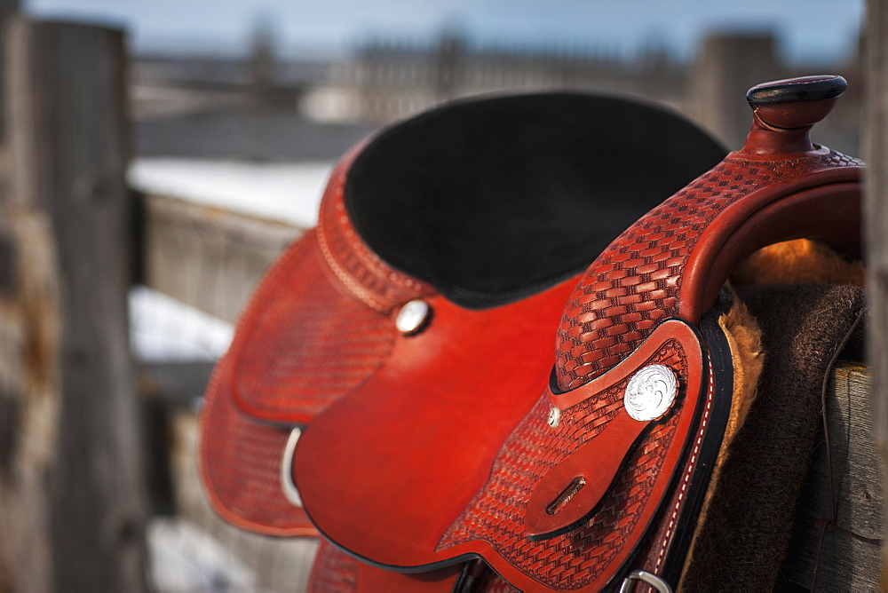 Close Up Of A Saddle On A Wooden Fence, Regina, Saskatchewan, Canada