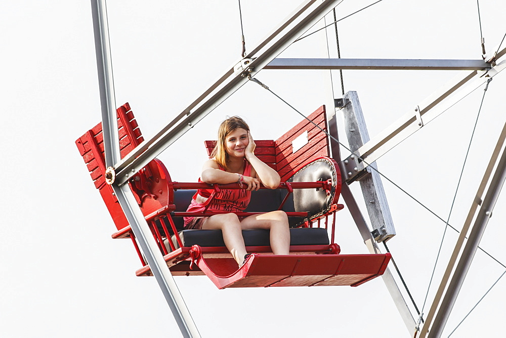 A Pre-Teen Girl Waiting Patiently For The Ferris Wheel To Load, Edmonton, Alberta, Canada