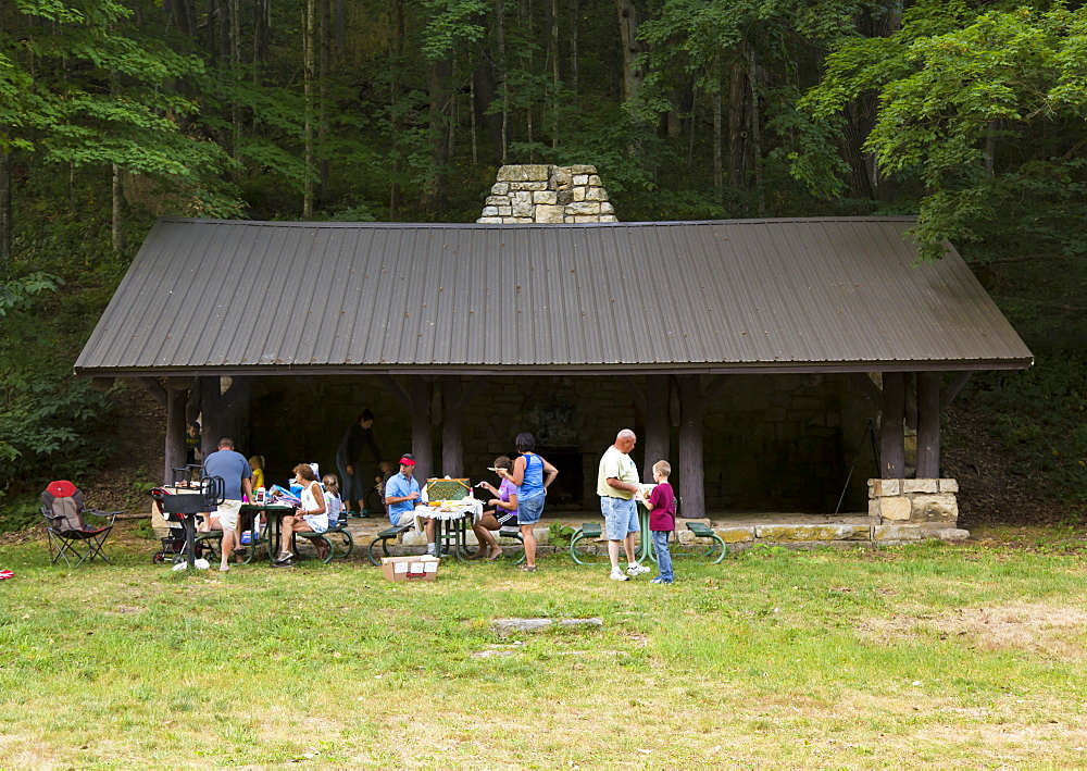 Family Having A Picnic At Bixby State Preserve, Near Edgewood, Iowa, United States Of America