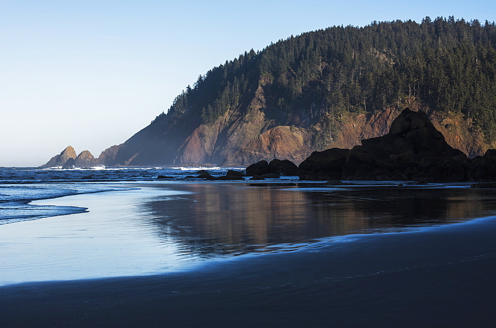 Morning Sunlight Warms Tillamook Head, Cannon Beach, Oregon, United States Of America