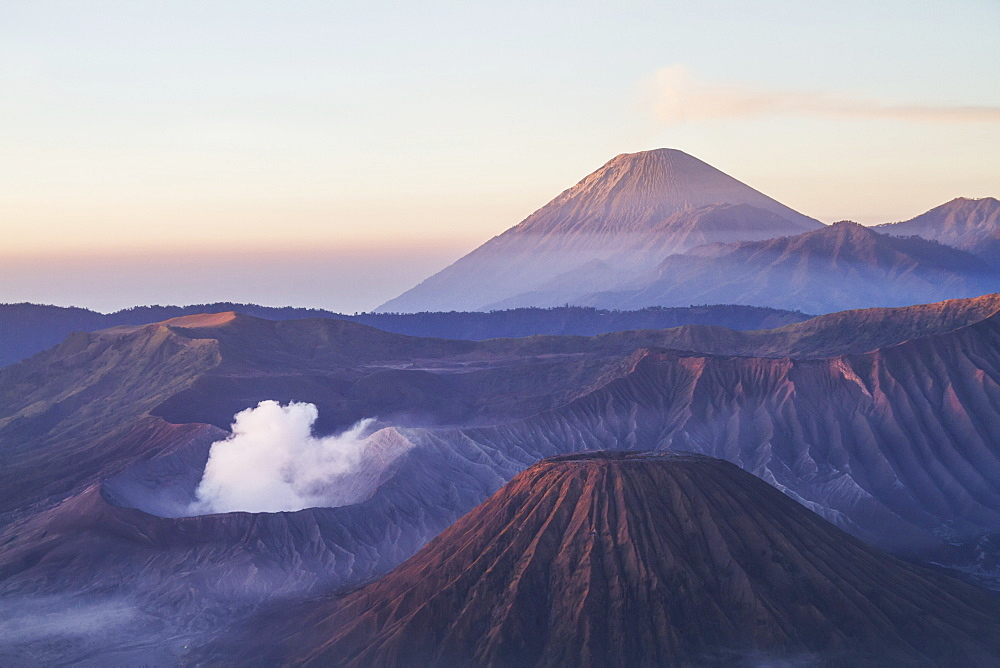 Tengger Caldera With Steaming Mount Bromo, Mount Batok And Mount Semeru In The Background, Seen From The Western Viewpoint At Dawn, Bromo Tengger Semeru National Park, East Java, Indonesia