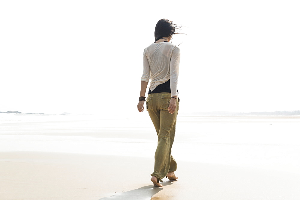 Young Woman Walking On The Beach, Huohu, Taiwan