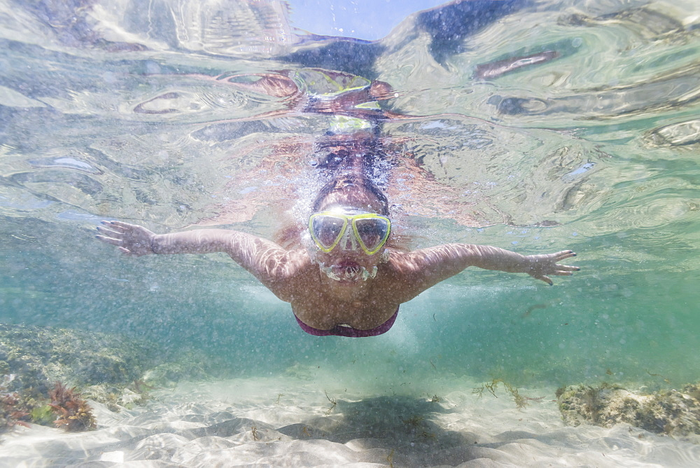 A Teenage Girl Swims Underwater Along The Water's Surface, Tarifa, Cadiz, Andalusia, Spain