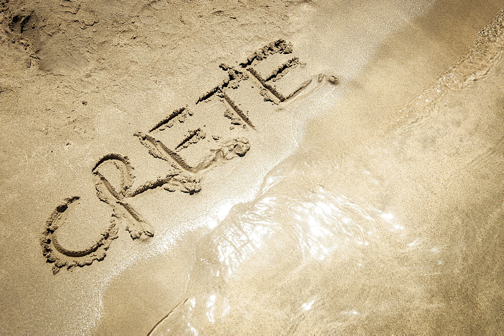 The Word Crete Written In The Sand At The Water's Edge, Elafonisi Beach, Crete, Greece