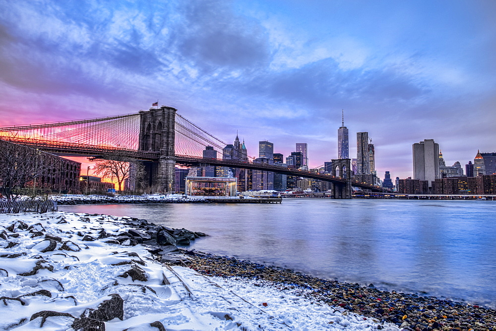 Brooklyn Bridge With Snow-Covered Landscape At Sunset, Brooklyn Bridge Park, Brooklyn, New York, United States Of America