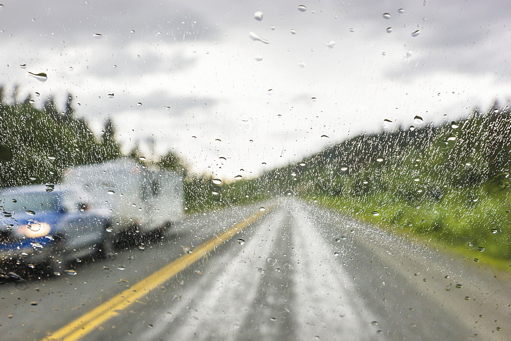 Rain On A Vehicle Window While On The Alaska Highway North Of Watson Lake, Yukon Territory, Canada, Summer