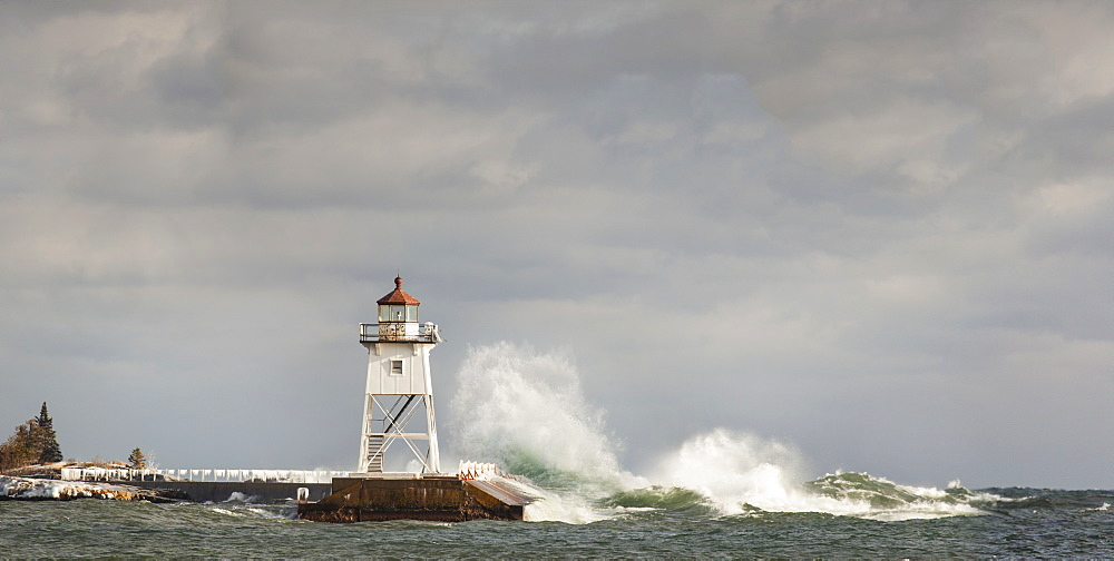 Large Waves Splashing Up To A Lighthouse, Grand Marais, Minnesota, United States Of America