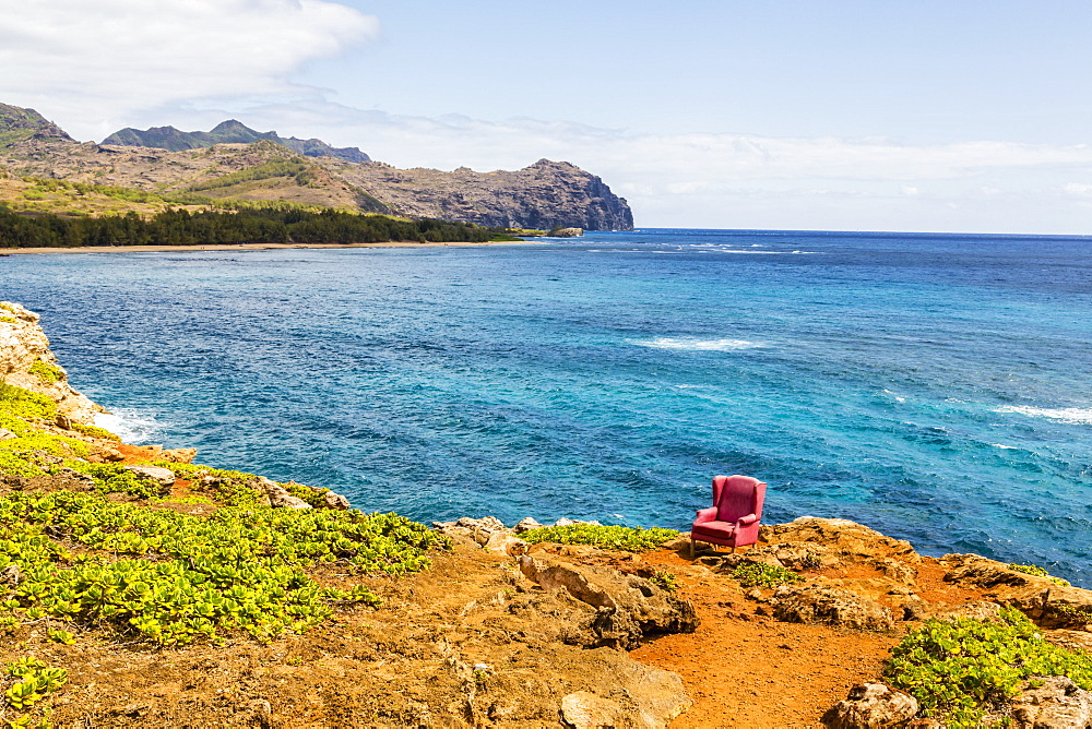 View Of A Red Stuffed Arm Chair Placed On A Cliff Edge, Poipu, Kauai, Hawaii, United States Of America