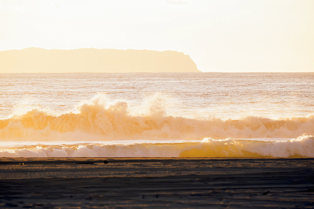 Golden Surf Visible From Barking Sands Beach In Kekaha With Niihau Visible In The Distance, Kekaha, Kauai, Hawaii, United States Of America