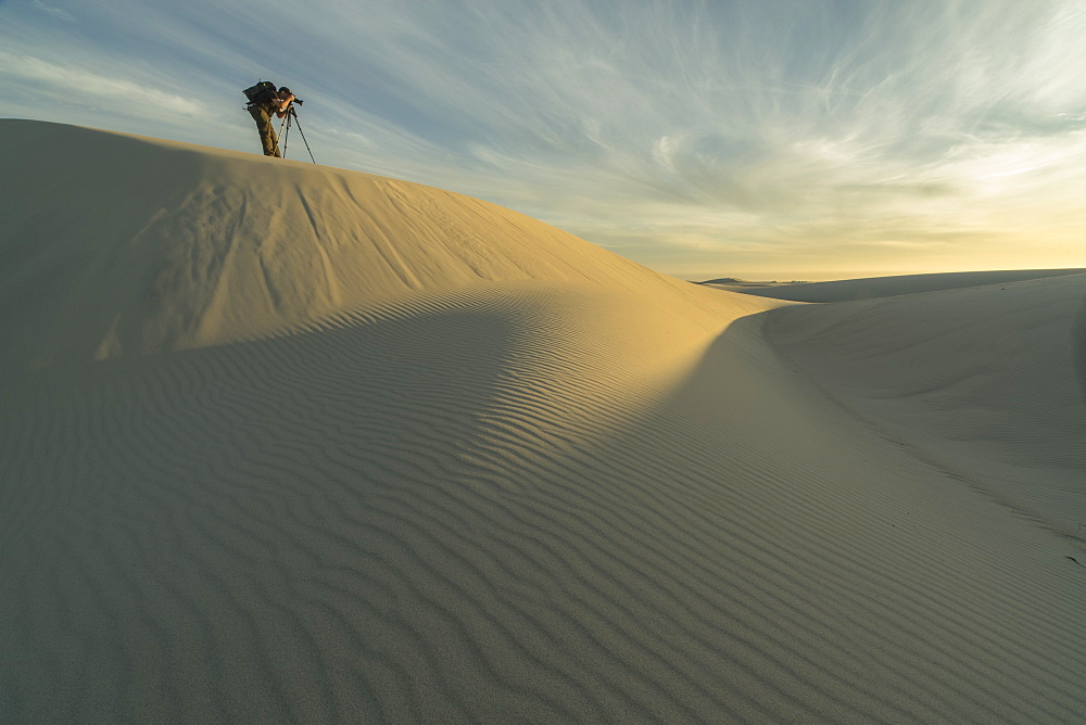 Person Taking Photos In The White Sand Desert Of Namakwaland National Park, South Africa