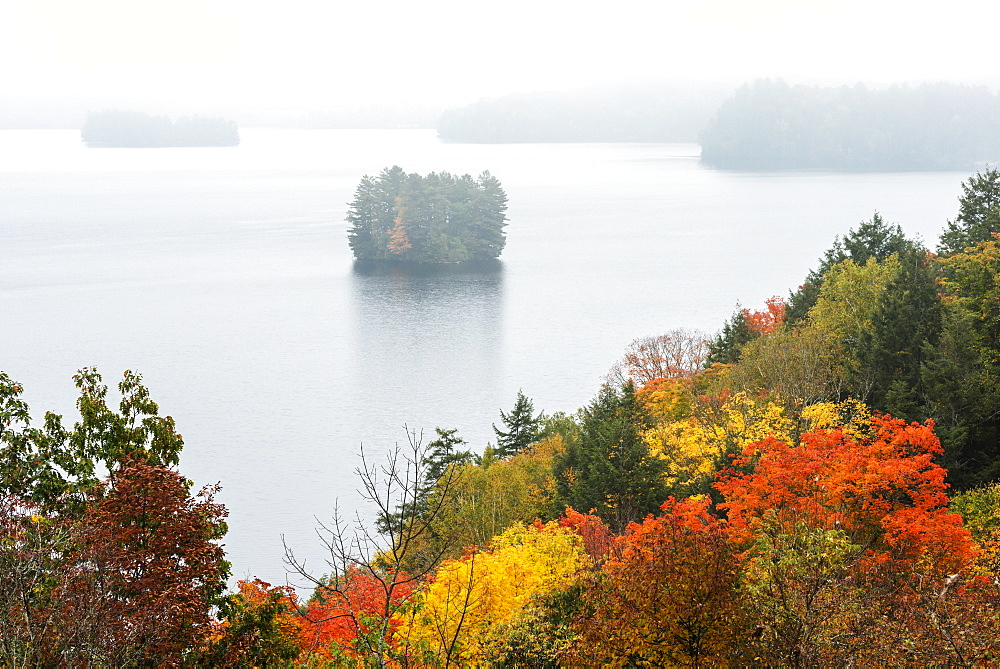 Bright Colours Of Trees In Autumn And Distant Misty Islands In Fairy Lake, Huntsville, Ontario, Canada