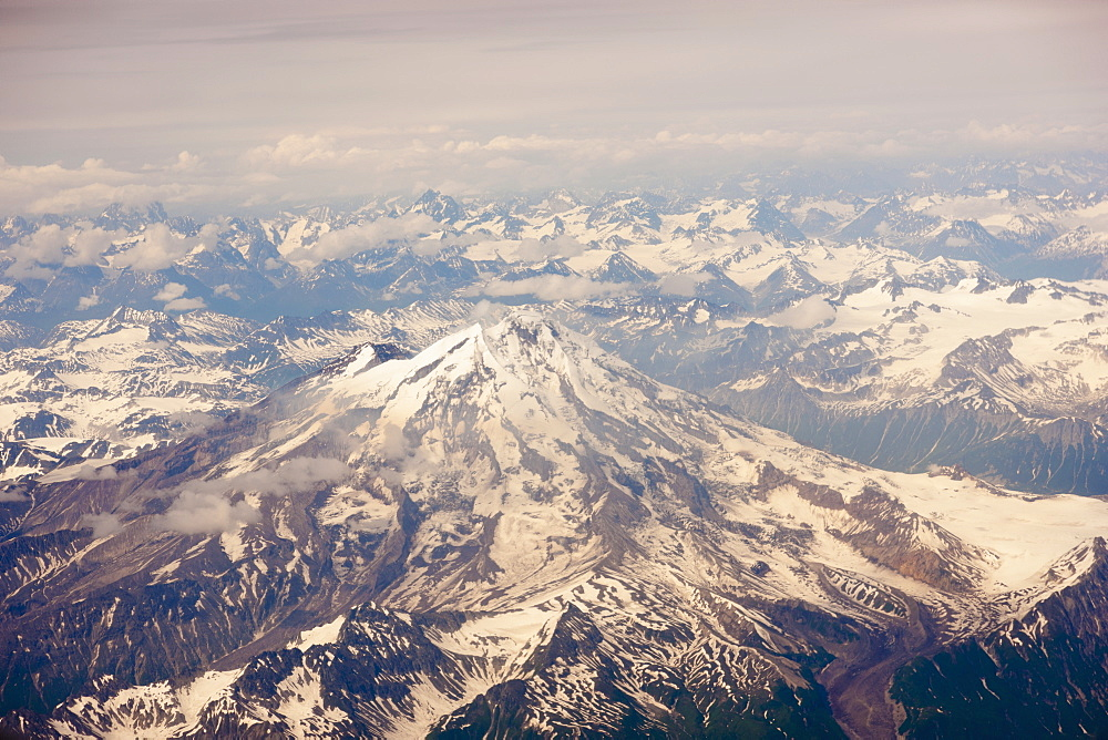 Aerial View Of Snow-Covered Mt. Iliamna And Surrounding Mountains Of The Aleutian Range, Alaska Peninsula, Southwestern Alaska, USA, Summer