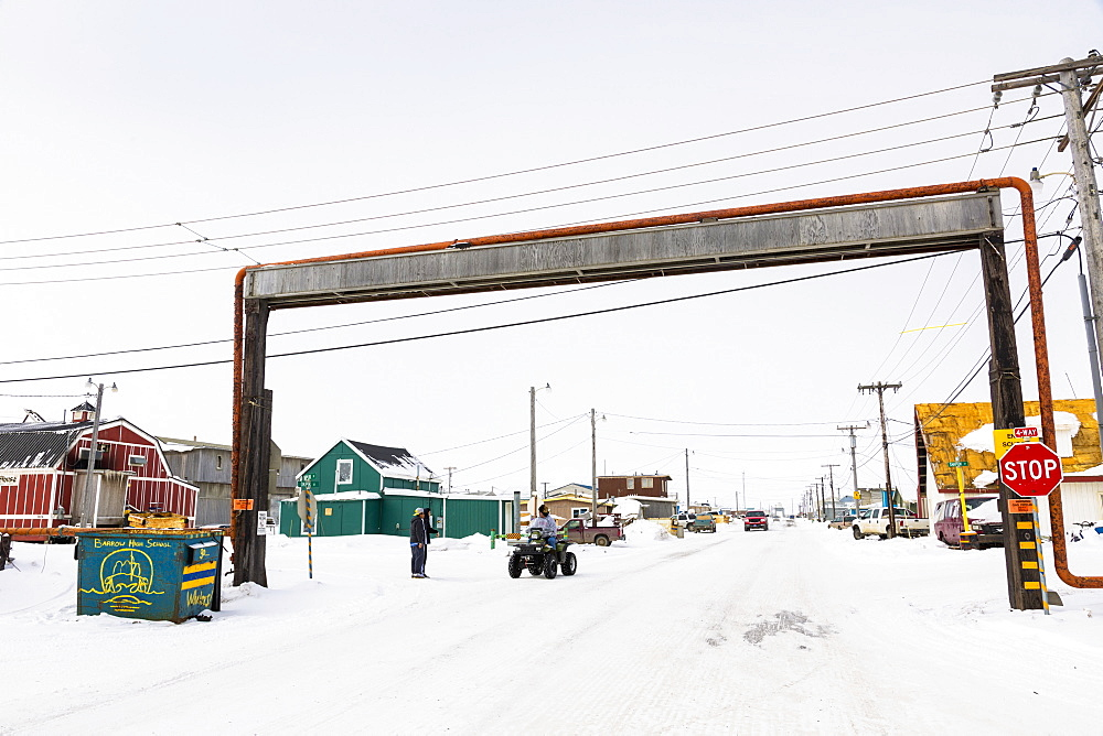 A Barrow Resident On An Atv Stops At A Above Ground Utilities Bridge, Barrow, North Slope, Arctic Alaska, USA, Winter