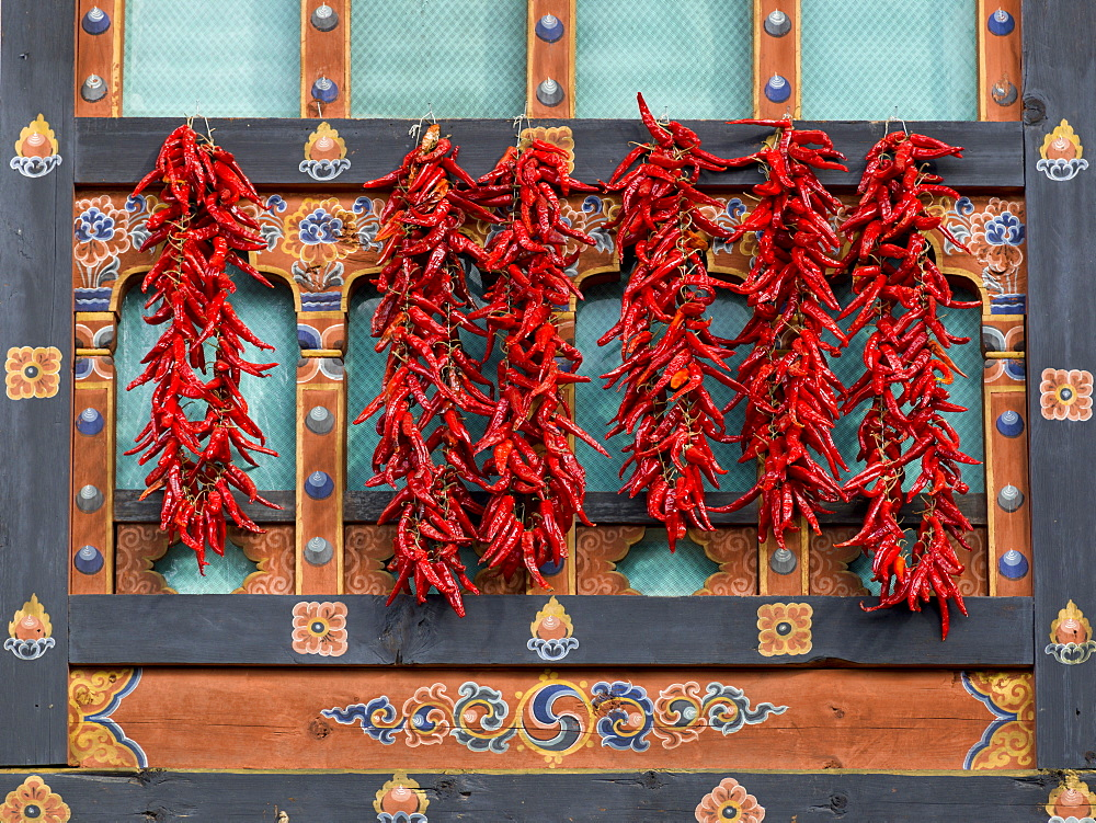 Red Peppers Hanging On An Ornate Wall, Paro, Bhutan