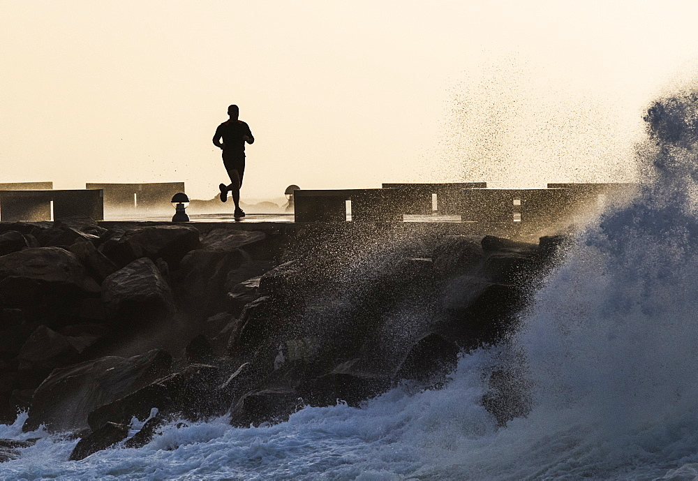 Silhouette Of A Man Running Along The Coast, La Isla, Tarifa, Cadiz, Andalusia, Spain