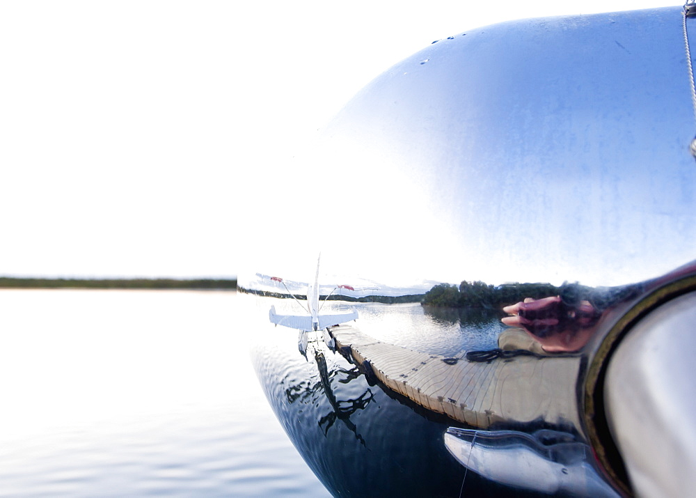Reflection In Nose Cone Of Floatplane, Alaska, United States Of America