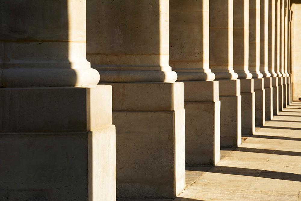 A Row Of Pillars At Palais Royal Form An Interesting Pattern, Paris, France