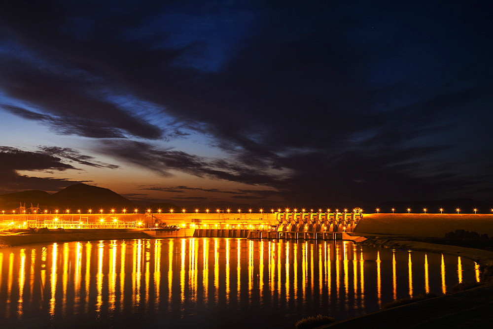 Dam Over The Euphrates River Lit Up At Nighttime, Turkey