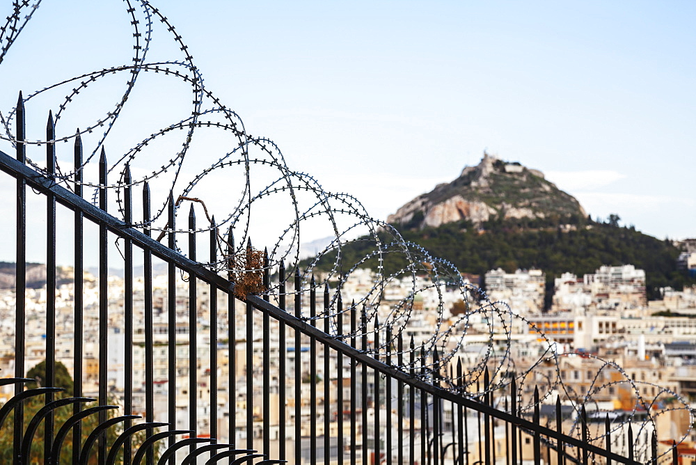 Mount Lycabettus And A Barbed Wire Fence, Athens, Greece