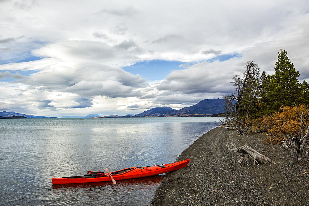 Kayak On The Shore Of Atlin Lake, British Columbia, Canada