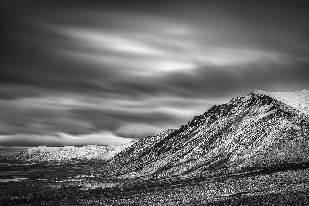 Black And White Long Exposure Of Clouds Over The Cloudy Range Along The Dempster Highway, Yukon, Canada