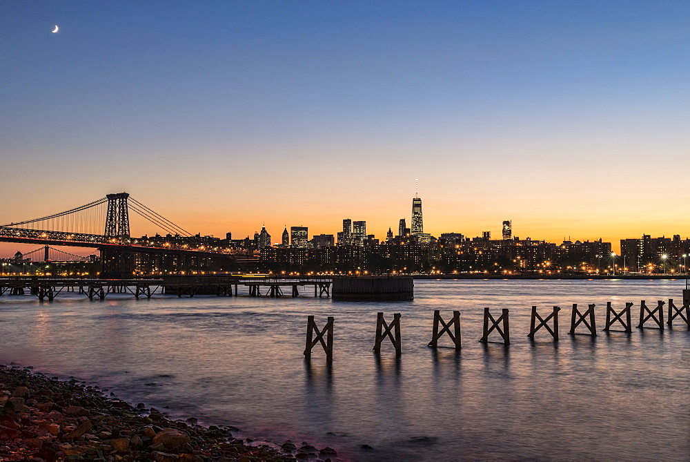 Sunset Over Lower Manhattan Near World Trade Center And Williamsberg Bridge, Brooklyn, New York, United States Of America