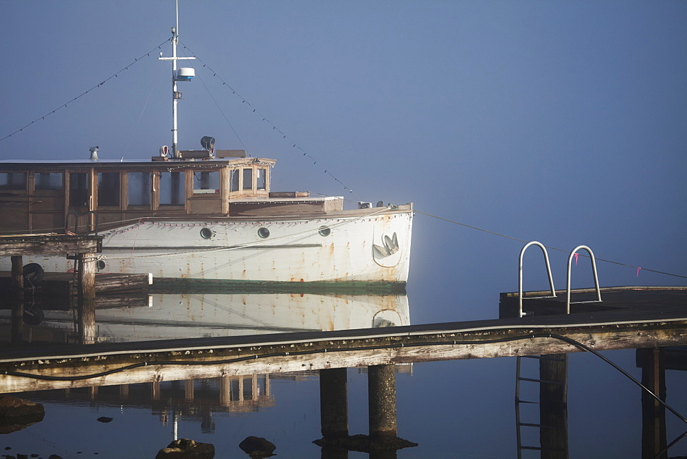 Wooden Boat On Foggy Lake, Bellingham, Washington, United States Of America