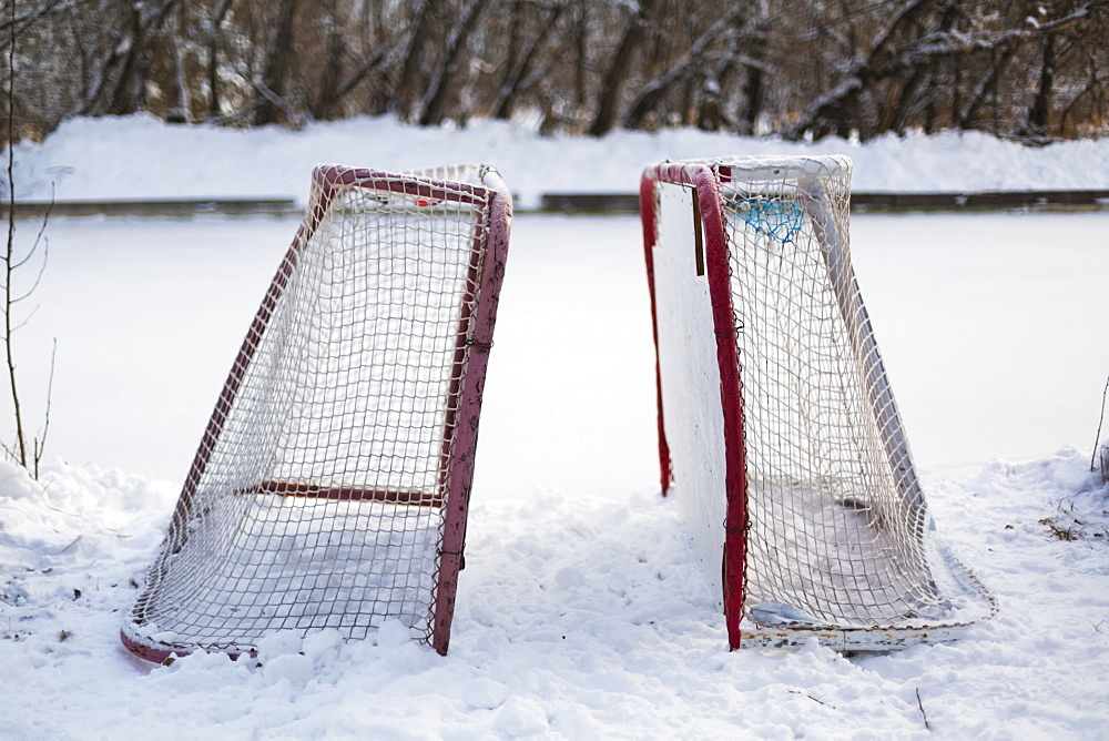 Two Hockey Nets In The Snow Beside A Frozen Outdoor Rink, Wetaskiwin, Alberta, Canada