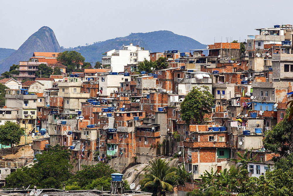 The View From Santa Teresa Looking Towards Sugarloaf Mountain With A Favela In The Foreground, Rio De Janeiro, Brazil