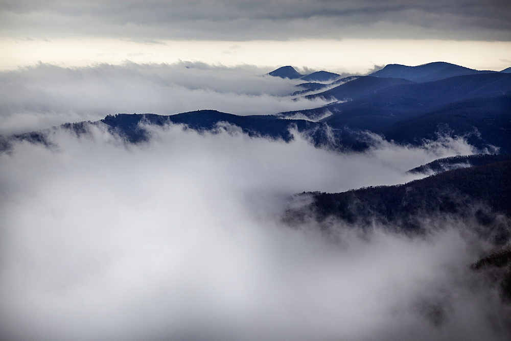 Looking Down On Storm Clouds Moving Up Western North Carolina Mountain Valleys With The Mountain Tops And High Ridges Visible, North Carolina, United States Of America