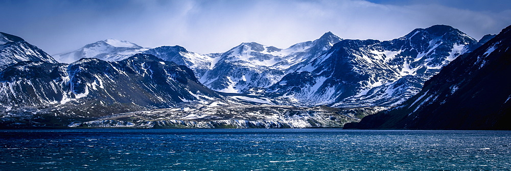 Snowy Mountains In Sunshine Beside Blue Sea, Antarctica