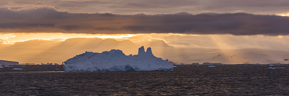 Jagged Iceberg In Silhouette Against Dawn Sky, Antarctica