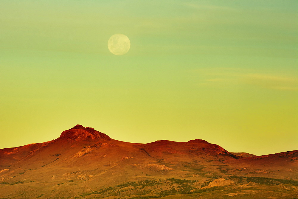The Moon Is Rising Over A Yellow Desert Landscape, Bariloche, Argentina