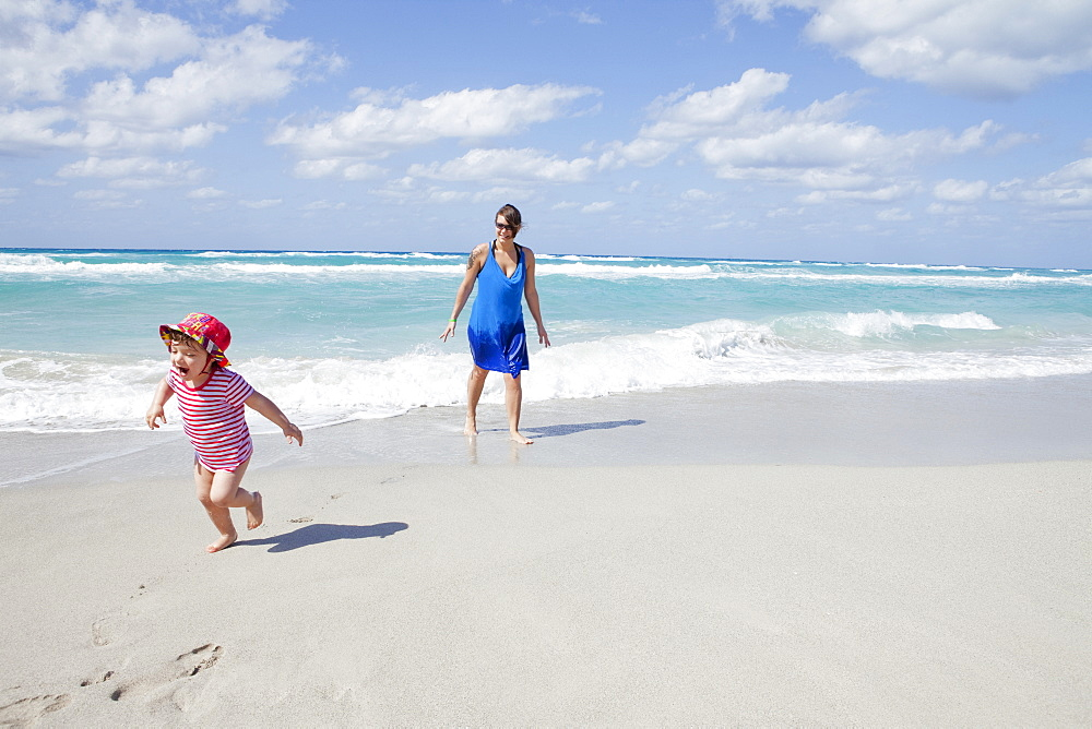 Child Running And Crying On The Beach With Her Mother, Varadero, Cuba