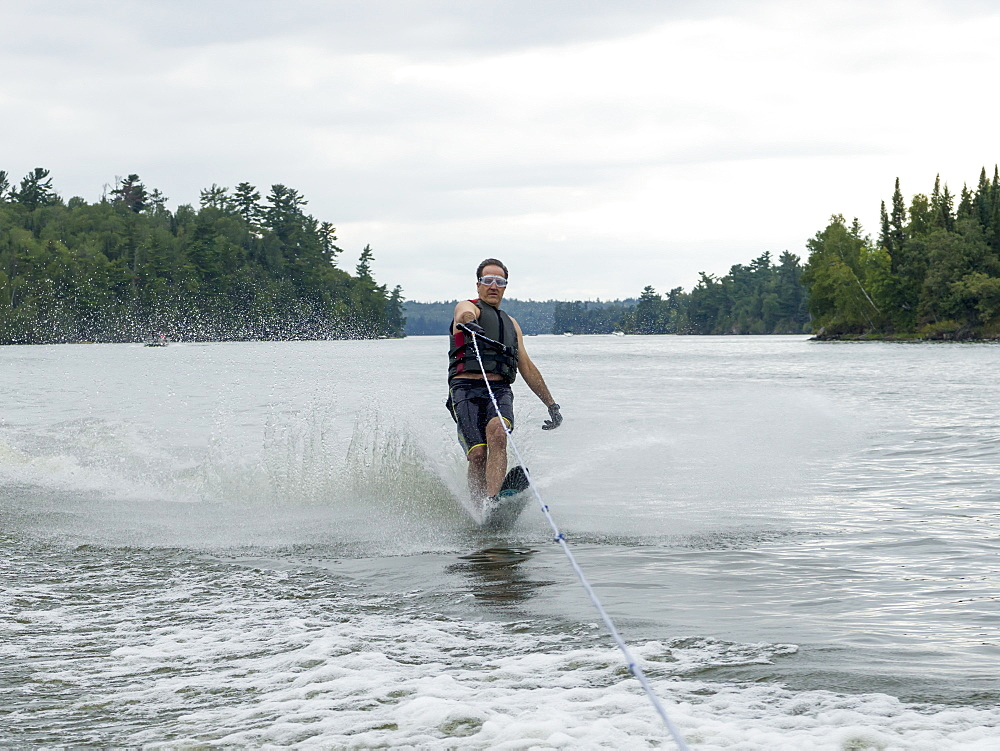 A Man Wake Boarding On A Lake, Ontario, Canada