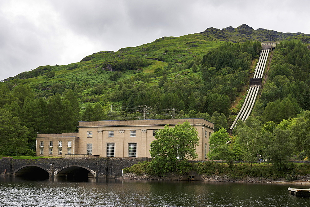 A Building On The Edge Of The Lake And Pipes Going Up The Hillside, Arrochar, Argyll And Bute, Scotland
