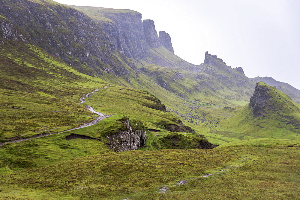 Fog Covers The Green Landscape With Cliffs And Peaks, Scotland