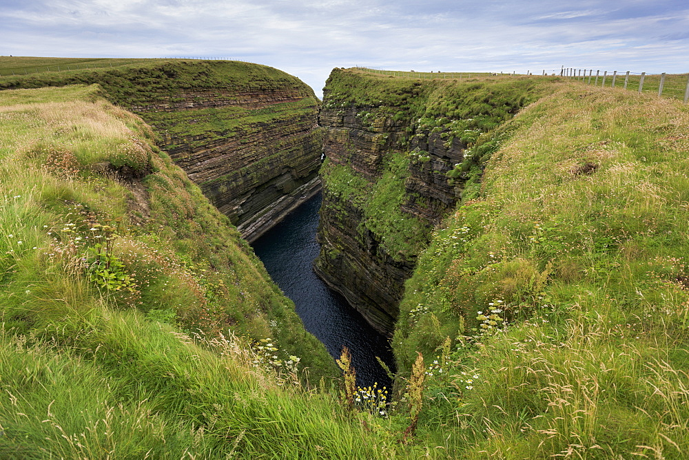 Water In A Gorge Between Grass Covered Cliffs, Caithness, Scotland