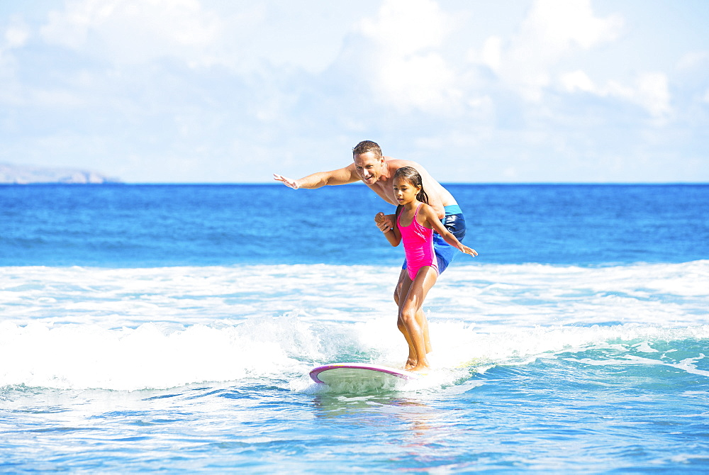 Father And Daughter Surfing Together Catching Wave, Summer Lifestyle Family Concept