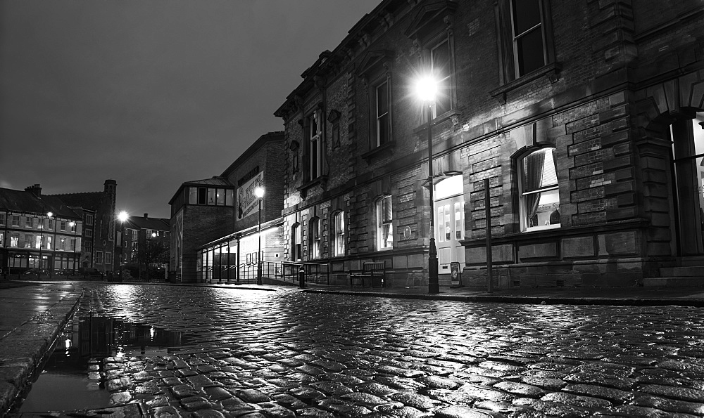 Light From A Lamp Post Illuminating Wet Cobblestone Road, South Shields, Tyne And Wear, England