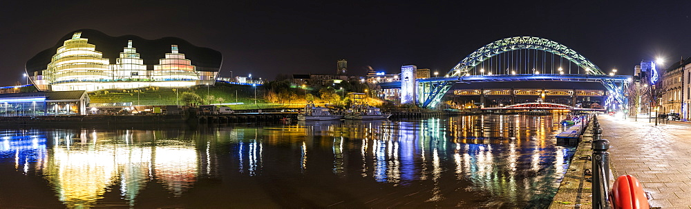 Tyne Bridge Illuminated At Nighttime Over River Tyne And Illuminated Buildings, Newcastle, Tyne And Wear, England
