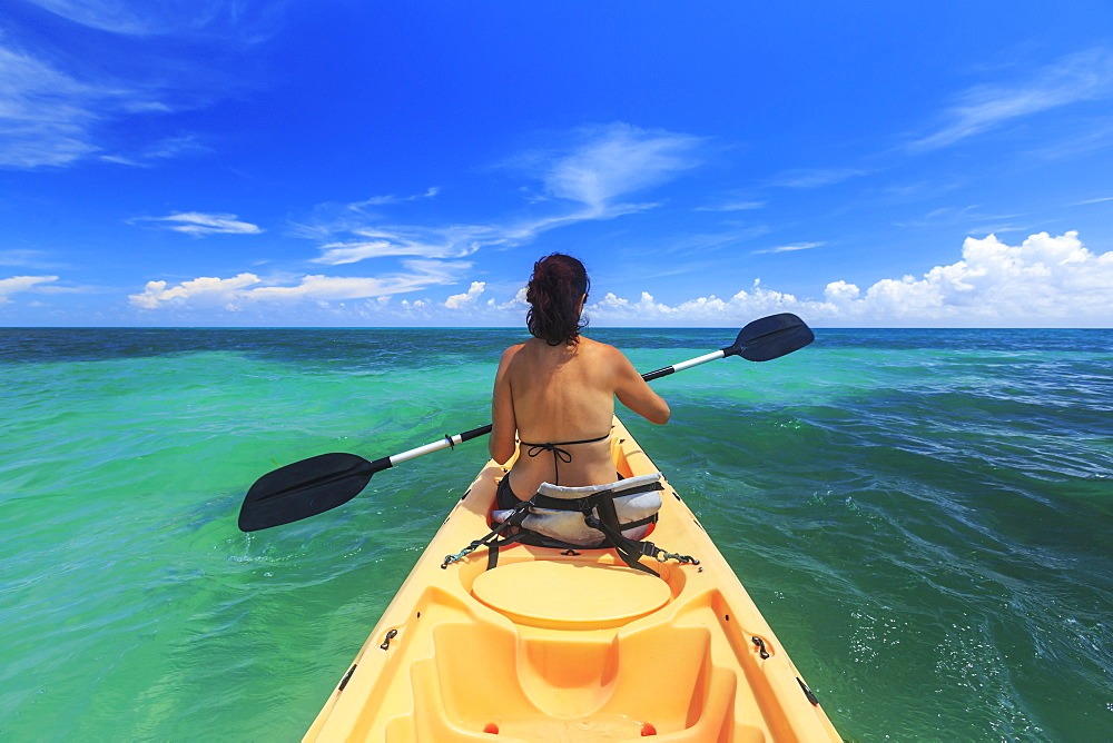 A Woman In A Bikini In A Kayak On The Caribbean, Saint Georges Caye Resort, Belize City, Belize