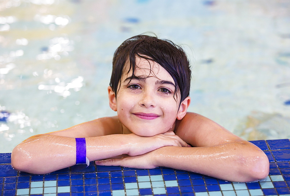 Young Boy In An Indoor Swimming Pool, Spruce Grove, Alberta, Canada