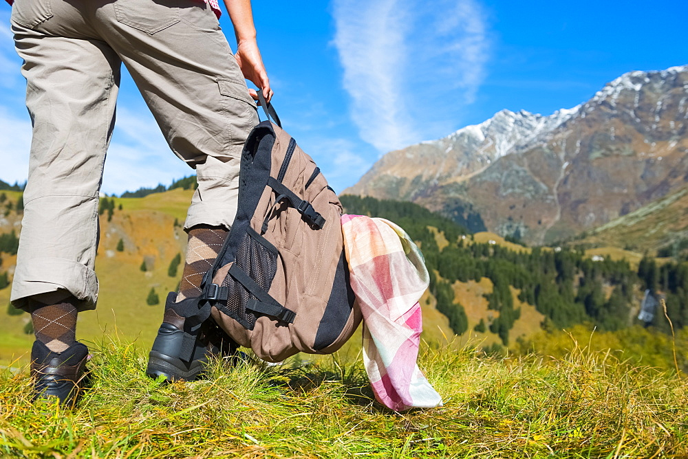 A Female Hiker In The Swiss Alps, San Bernardino, Grisons, Switzerland