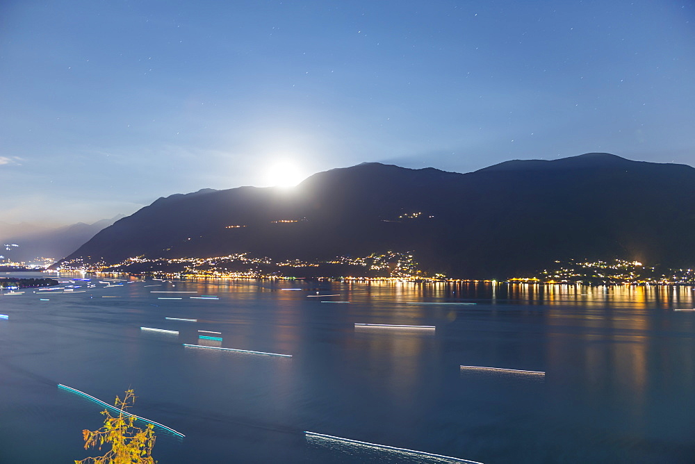 Moonlight Shining Over The Swiss Alps And Lake Maggiore, Ascona, Ticino, Switzerland