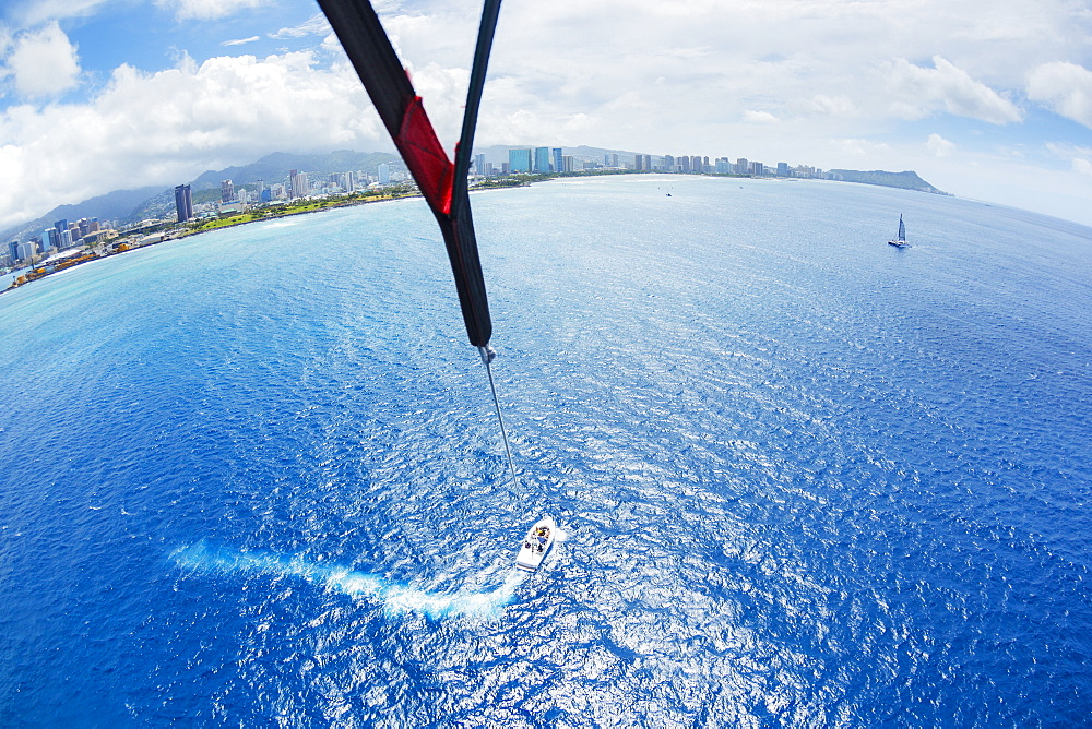Parasailing Over Ocean In Hawaii, View From Up In The Sky