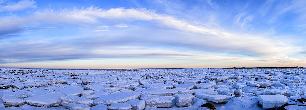 Ice Forms On The Shores Of Hudson Bay As Sunset Starts To Light Up The Clouds, Churchill, Manitoba, Canada