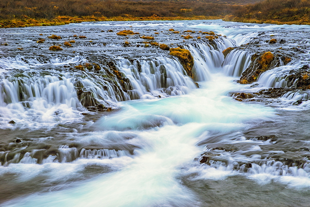 Water Cascading Over Rocks And Flowing Into A River, Bruarfoss, Iceland