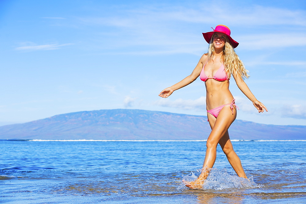 Beautiful Woman Walking On Tropical Beach