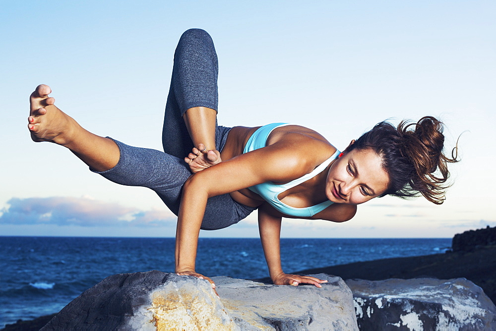 Athletic Strong Woman Practicing Difficult Yoga Pose Outdoors